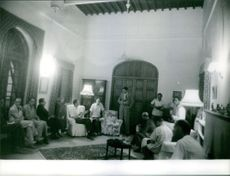 People gathered together in a house and having discussion in Kuwait, 1961.