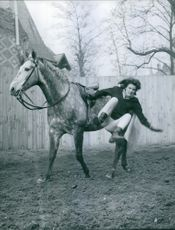 Irène Tunc pictured falling down from the horse. 1961.