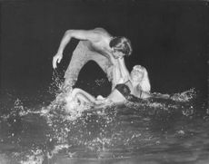 Couple playing in water.