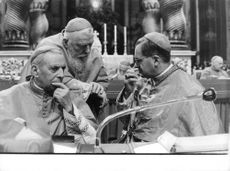 Pope Paul VI with a men, contemplating.