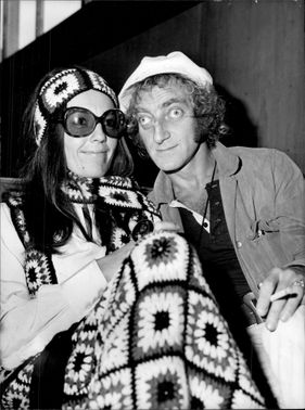 Marty Feldman and his wife Loretta Sulliman arrive at Heathrow Airport.