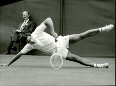 Roger Taylor falls by matc against Dick Crealey