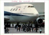 Aircraft Skyjack All Nippon 747 1995: Police storm the hijacked, jumbo jets at Hakodate airport.