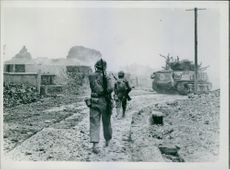 Step by step, U.S. Marines led by a tank move on towards the last strong point of Jap resistance which finally collapsed after 82 days of fighting.  The 82-day-long battle lasted from 1 April until 22 June 1945.  The Battle of Okinawa, Operation Iceberg,