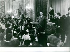 Charles de Gaulle giving his speech with children as part of his listeners.  - Dec 1962