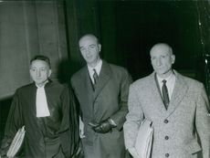 Gaston Naessens with the police magistrate. 1964.