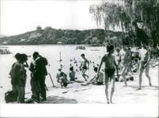 People enjoying and relaxing by the beach.