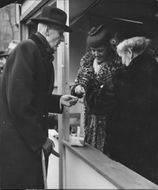 Prince Carl buys lottery tickets at the Red Cross raffle - 18 May 1944
