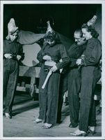 Scalagirls as air protection helper. The air guard is checked by the air guard. An ax is also part of a proper equipment1940