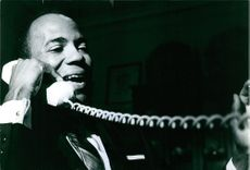 James Meredith talking on telephone.