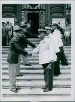 General Fitts shakes hands with General Borejko in the Vienna area, after the changing of the guard ceremonies.
