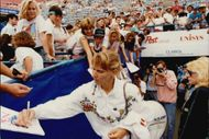 Steffi Graf writes autographs to their fans during the US Open