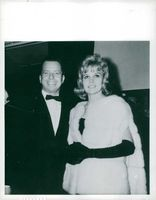 Carroll Baker with a man, wearing a gown.