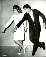 Black and white photography on actors Dick Van Dyke and Sally Ann Howes.