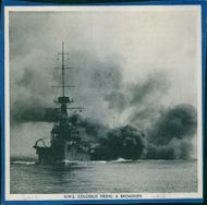 H.M.S Colossus firing a broadside, 1935.
