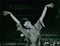 A photo of a woman practicing on stage.