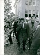 James Meredith walking with few other men.