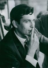 French politician Rene Piquet touching his lips with his fingers, 1971.
