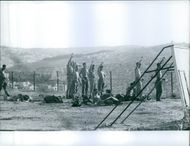 Soldiers standing while raising hands in the ground in Lebanon.