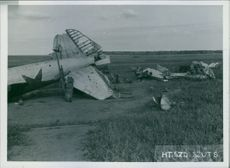 A crashed aircraft in the field.