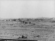 Group of soldiers in the horizon setting up a canon in Israel.