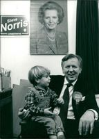 Steven John Norris with his son.