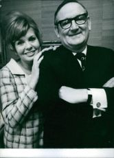 Richard Tompkins posing with his wife Elizabeth Tompkins.
