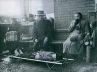Sir Walter Forest looking the boy in stretcher.