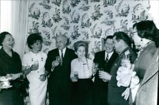Valentina Tereshkova are in a party along with Andriyan Nikolayev and some people.