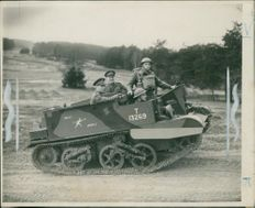 King's first ride in a Bren Gun Carrier when visiting Canadian troops in training near Aldershot. With him Maj.-Gen. V. Odlum