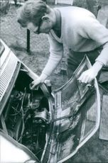 "Gordon Dikes repairing a vehicle.  ""Gordon Dikes"""