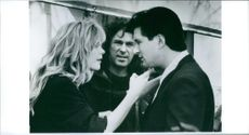 Director Norman René with Alec Baldwin and Meg Ryan shooting a scene for the movie Prelude to a Kiss, 1992.
