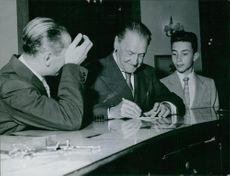 William Somerset Maugham signing autograph.