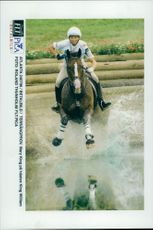 Mary King on Horse King William forces the water barrier in the terrain of the field competition.
