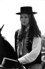 Leigh Taylor-Young riding on a horse.