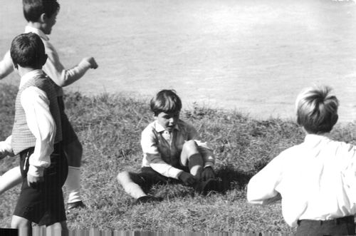 Claudia Cardinale`s son tying his shoe lace.