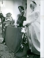 1970 A portrait of a bride and groom standing during ceremony.