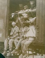 Soldiers sitting together inside the rail coach.
