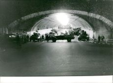 Soldiers gathered in a tunnel.