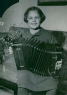 Eight-year-old Siv plays accordion