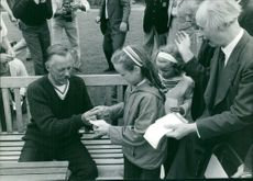 Bob Maury giving autographs to children while vacationing in Falmouth, Cornwall, UK.