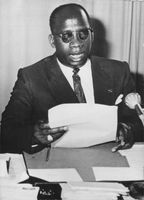 Godefroid Munongo at a press conference.