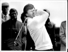 Action shot on Nick Faldo taken in an unknown context.