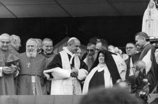 Pope Paul VI standing and having conversation with the people, 1967.