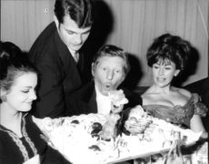 Danny Kaye enjoying with friends.