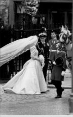 Prince Andrew and Sarah Ferguson leave Westminster Abbey after the wedding has taken place.