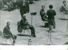 Women swimmers, sitting on the chair, preparing, October 1964.