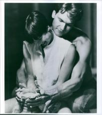 "A photo of Patrik Swayze and Demi Moore in the clay molding in a film ""Ghost"" 1990"