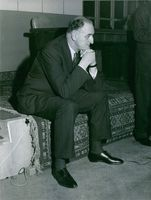 Pierre Marcilhacy sitting at the hall. 1965.