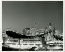 In the foreground is the saddle-shaped Olympic venue and in the center of central Calgary.